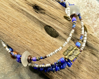 Maine sea glass and blue lapis and purple toned beaded  adjustable wrap bracelet  fun and eco-friendly ocean style fashion statement jewelry