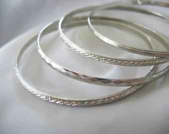Stackable Bangle Bracelets, Silvertone, Set of Four, 5mm wide, 1970s, Stamped Design, Mid Century, Minimalist