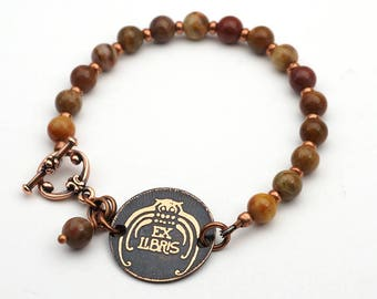 Copper owl bracelet, metal etching, fossilized wood beads, earthtones, 7 1/2 inches long