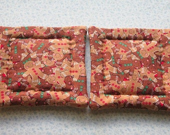 brown gingerbread man with a touch of glitter hand quilted set of 2 potholders hot pads