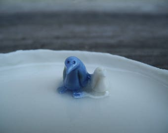 Spoon rest in white porcelain - trinket dish with two penguin like birds