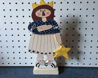 Adorable wood hand crafted Statue of Liberty 10 1/2 inches L x 4 Inches wide. Weighs Weighs 5.6 oz.  1/2 in thick w