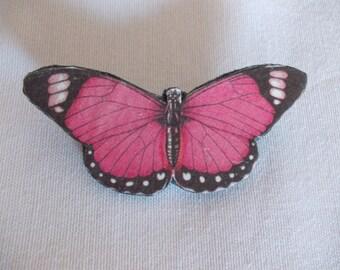 Butterfly-shaped brooch on skin