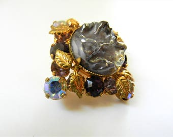 1950s  lovely square shaped brooch with iridescent chunky purple lava fantasy stone, AB chatons and golden foliage ornament -  art.828/4