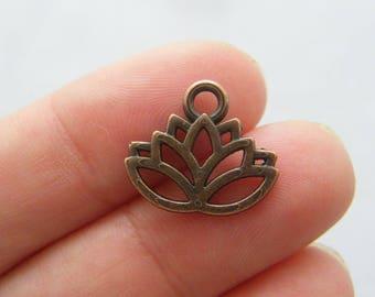 10 Lotus flower charms antique copper tone CC19