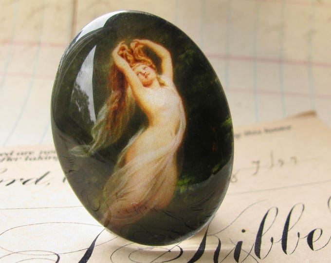 From our Magical Maidens collection, handmade 40x30mm glass oval cabochon, flying nude, pearls in her hair, vintage fantasy, flying dream