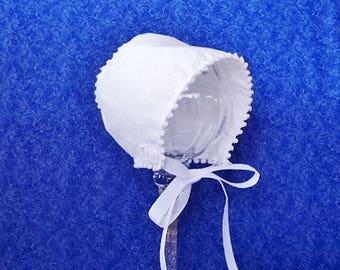 Off-White Baby Bonnet with Pom-Pom Trim