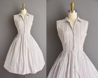 vintage 1950s dress. 50s burnt orange and blue cotton stripe vintage dress