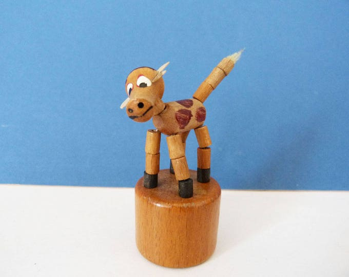 vintage wooden collapsing fall down toy cow