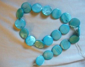 Beads,  Mother of Pearl, 20mm Flat Round Coin, Shades of  Blue. Sold per 15 inch strand. There are 20 beads on this strand.