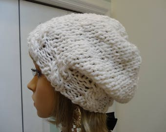 WHITE WINTER HAT,Sparkling white, bulky knit yarn, wide forehead cable stitch,slouchy style ,loose back hat, one size fits most adults