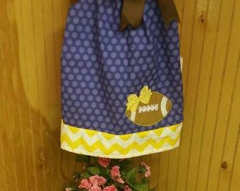 Custom boutique pillowcase dress with football applique