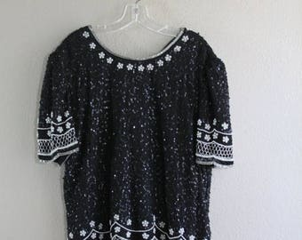 SALE black sequin & beaded top with white floral pattern- SALE