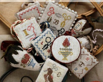 Pre-order 2018 Nashville Market HEARTSTRING SAMPLERY Festive Little Fobs counted cross stitch patterns at thecottageneedle.com