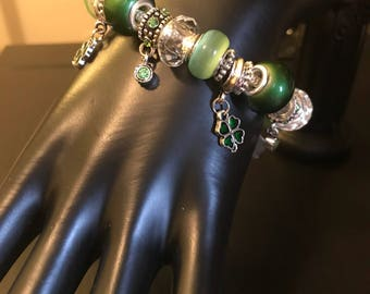 Green and clear shamrock and crystal charm bracelet