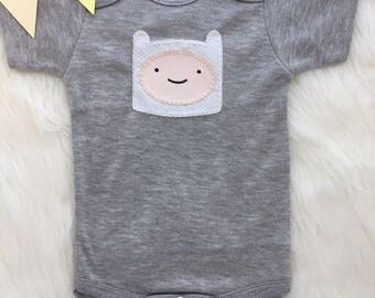 Baby bodysuit with hand sewn Finn from Adventure Time applique, adventure time inspired baby outfit- personalize with your baby's name!