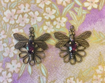 1 pair of Dragonfly and Swarovski crystal connectors, with Amethyst Navette stones. Antique brass colour.