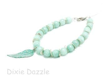 Aqua blue beaded bracelet with wing charm,summer vacation style, jade bracelet, boho bracelet, pastel jewelry, aqua green, resort wear