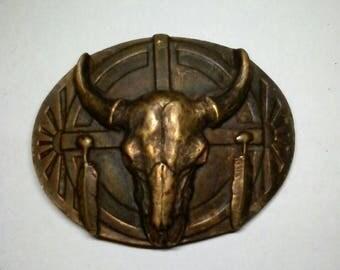 Belt buckle with buffalo skull