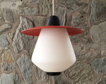 Mid-century Louis Kalff for Philips Holland opal glass pendant light with red metal shade (refinished). Dutch modernist design.