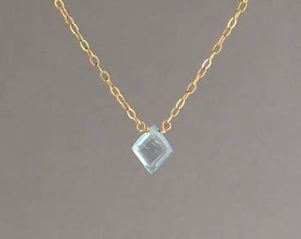 Blue Topaz Diamond Necklace available in gold, rose gold, or silver