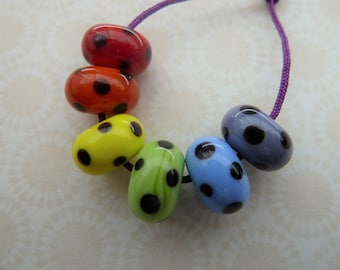 handmade lampwork rainbow and black spots set, UK beads