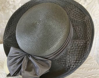 Vintage 1970s HAT. Slate Grey Rounded Crown, Turned Up Brim and 5 Layered Bow, Matching Hat Band With Veil.