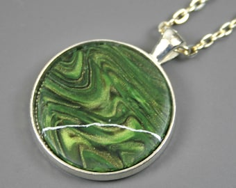 CLEARANCE SALE - Kintsugi (kintsukuroi) pendant in swirled shimmering green polymer clay with silver repair in a silver bezel setting - OOAK
