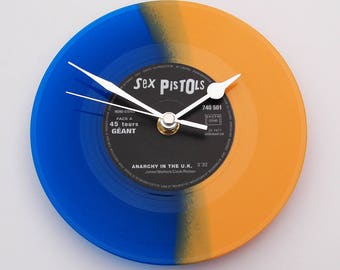 """The SEX PISTOLS Clock made from a recycled 7"""" single, """"Anarchy in the UK"""", Blue and Orange Coloured Colored vinyl Punk Rock Clock gift"""