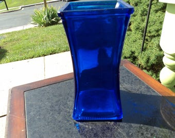 Small uniquely shaped vase in cobalt blue glass/gorgeous color