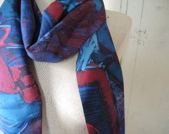 Vintage 1970s polyester scarf abstract blues and reds  7 x 64 inches
