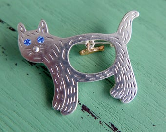 Brooch cat and fish