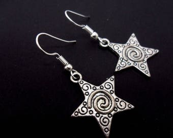 A pair of pretty hand made tibetan silver star dangly earrings. new.