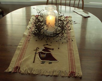 Wool applique Christmas table runner with Santa and his sleigh