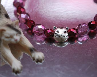 Br-35 Cat-bracelet, beaded stretch bracelet, faceted round watermelon & red metallic Czech fire polished glass beads, silver plated cat bead
