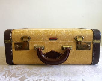 1930s Lincoln trademark, New York tweed traveler, leather trim and handle, embossed tweed hardshell, brass