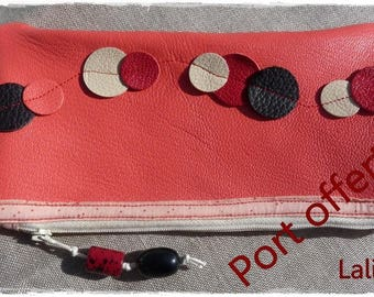Coral leather clutch decorated with round leather