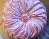 pink round hand sewn pillow