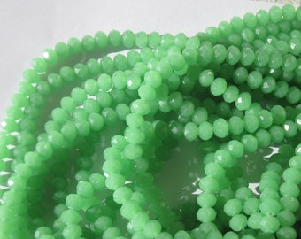 10 glass opaque 5 to 6mm (79) Green faceted beads-