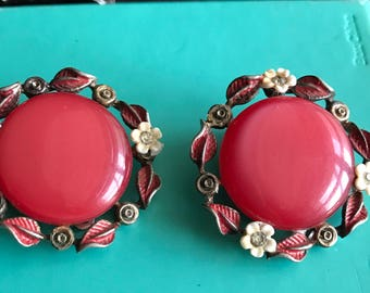 Pair of vintage clip on earrings with pink center