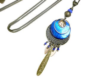 Long pendant necklace, blue , black and silver beaded, brass jewel