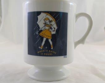 Morton Salt Anniversary Pedestal Mug featuring 1956 Salt Girl When It Rains It Pours