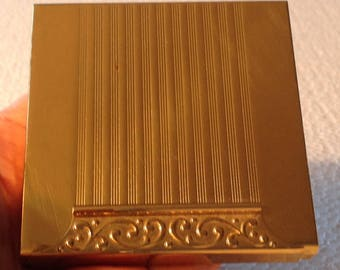 Vintage Avon compact. Gold tone square. Heavy brass metal. For pressed powder.