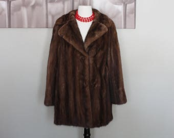 Mint condition Mink Fur coat from Albrechts, long sleeve, thigh length