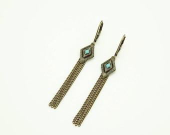 Earrings with diamond and blue enamel