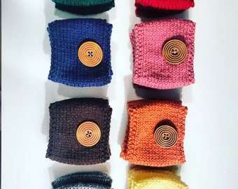 handmade knit coffee cozy with wooden button