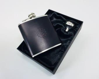 Leather Hip Flask in high quality vegetable tanned leather, embossed design, laced at back, 6 fluid oz. with funnel.   Free Shipping in UK.