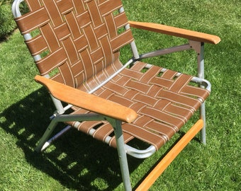 Webbed lawn chair with wood handles, clamping, camping