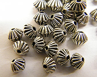 Beads and Tibetan silver, by 50 pieces