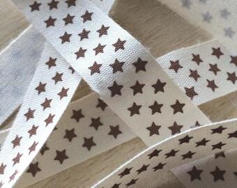 "decorative Ribbon: ""chocolate stars"" on an ecru background"